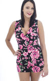 Attractive Young Woman Wearing a Short Floral Playsuit Stock Photo