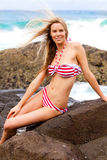 Attractive young Woman Wearing a Striped Bikini Royalty Free Stock Image