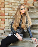 Attractive young woman wearing sunglasses - outdoor portrait Stock Images