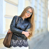 Attractive young woman wearing sunglasses Royalty Free Stock Photo
