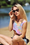 Attractive young woman wearing sunglasses Stock Image