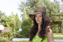 Attractive young woman wearing sunhat in park Royalty Free Stock Image