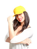Attractive young woman wearing a yellow baseball cap Stock Photos