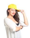 Attractive young woman wearing a yellow baseball cap Royalty Free Stock Photo