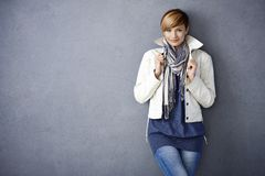 Attractive young woman in white jacket Stock Image