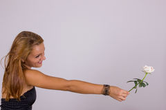 Attractive young woman with white rose Stock Image