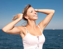Attractive young woman in white at the sea Stock Image
