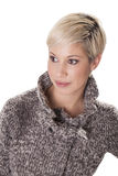 Attractive young woman in a winter coat looks to the side. Trendy young woman smiles with her jacket isolated on white background Stock Images