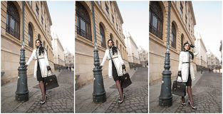 Attractive young woman in a winter fashion shot. Beautiful fashionable young girl in black and white outfit posing on avenue Royalty Free Stock Image