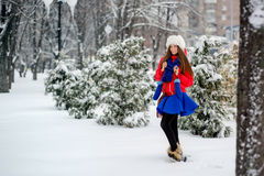 Attractive young woman in winter time outdoor. The girl in colored clothing. Royalty Free Stock Photography