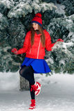 Attractive young woman in winter time outdoor. The girl in colored clothing. Royalty Free Stock Photo