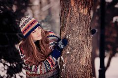 Attractive young woman in wintertime outdoor.  Royalty Free Stock Photos