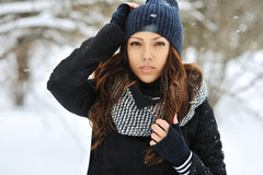 Attractive young woman in wintertime outdoor Stock Image