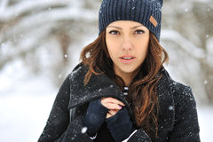 Attractive young woman in wintertime outdoor Royalty Free Stock Image