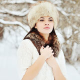 Attractive young woman in wintertime outdoor Royalty Free Stock Images