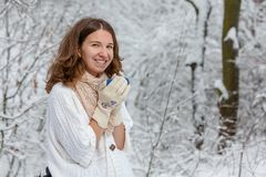 Attractive young woman in wintertime outdoor.  Royalty Free Stock Images