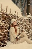 Attractive young woman in wintertime outdoor.  Royalty Free Stock Image