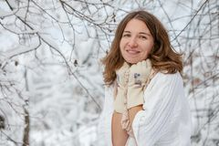 Attractive young woman in wintertime outdoor.  Royalty Free Stock Photo