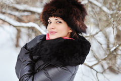 Attractive young woman in wintertime outdoor - close up Royalty Free Stock Photo
