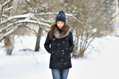 Attractive young woman in wintertime - outdoors portrait Royalty Free Stock Photo