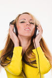 Attractive Young Woman With Headphones Over White Stock Images