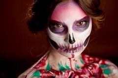 Attractive Young Woman With Sugar Skull Halloween Makeup Stock Photography