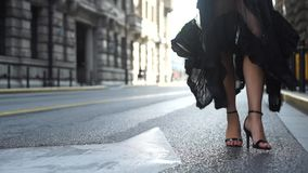 Attractive young woman in wonderful dress are walking on the street. Attractive young hispanic woman in wonderful black dress are walking on the street. red lips stock video footage