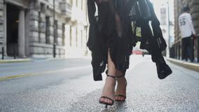 Attractive young woman in wonderful dress are walking on the street. Attractive young hispanic woman in wonderful black dress are walking on the street. red lips stock footage