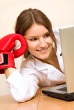 Attractive young woman at work place Stock Photo