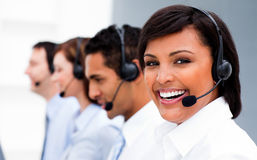 Attractive young woman working in a call center Royalty Free Stock Photography