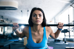 Attractive young woman working out with barbell Stock Images