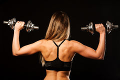 Attractive young woman working out with dumbbells - bikini fitne Royalty Free Stock Image