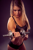 Attractive young woman working out with dumbbells - bikini fitne Stock Image
