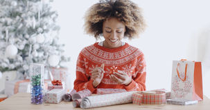 Attractive young woman wrapping Christmas gifts Stock Photos