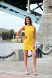 Attractive young woman in yellow dress Royalty Free Stock Photos