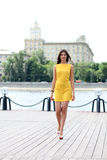 Attractive young woman in yellow dress Stock Photography