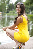 Attractive young woman in yellow dress Royalty Free Stock Image