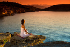 Attractive young woman in a yoga position on a beautiful beach. Island of Rab Stock Photography