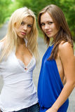 Attractive young women. Two attractive young women on the road royalty free stock images