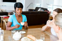 Happy young woman with cup of tea or coffee at home Stock Photography