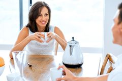 Happy young woman with cup of tea or coffee at home Royalty Free Stock Photography