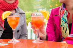 Attractive young women enjoying cocktails in an outdoor bar Stock Image