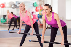 Attractive young women are exercising in gym Stock Photography