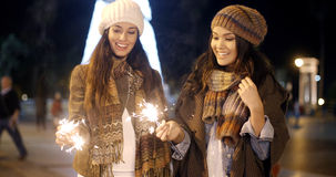 Attractive young women having fun at Christmas stock photography