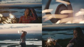 4 in 1: Attractive young women posing on the hill with the sparklers stock footage