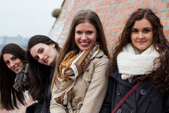 Attractive young women, smiling and embracing Royalty Free Stock Image