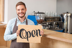 Attractive young worker is inviting in coffee shop Royalty Free Stock Photo