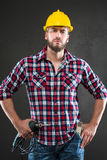 Attractive young workman with drill Royalty Free Stock Photos