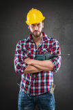 Attractive young workman with drill Stock Photos