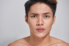 Attractive youthful naked male is expressing confidence.  stock image